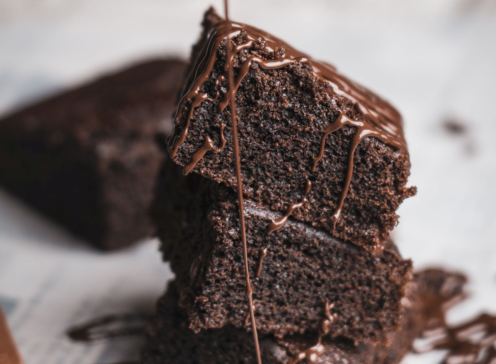 chocolate cake with chocolate sauce drizzled on top